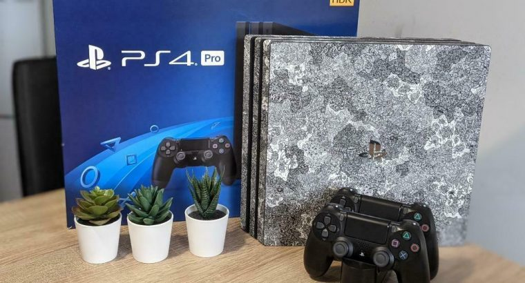 PlayStation 4 Pro (1TB) met 2 Controller (dbrand Robot Skin)